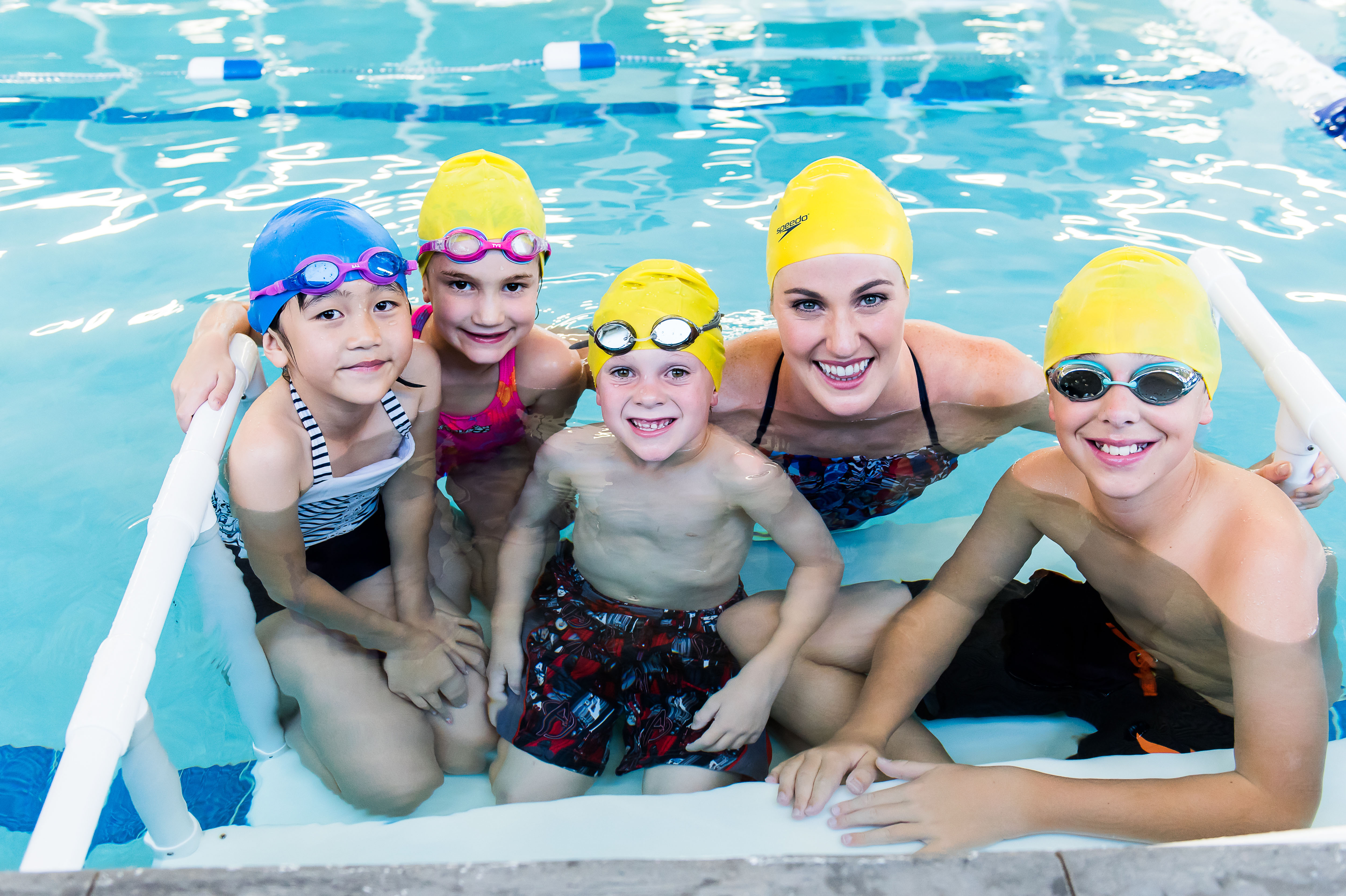 Missy Franklin Posing with Students during Swimming Lessons