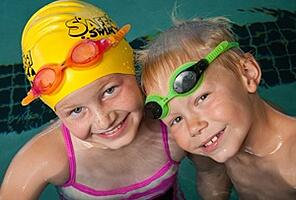Boy and Girl Students pose for picture during Swimming Lessons