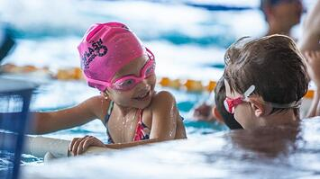 Kids smiling during Safesplash swimming lessons